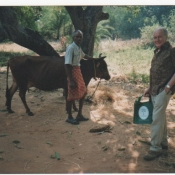 John Kendall and cow man with his Neem Tree Trust bag in Chhattisgarh, Central India