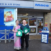 George Stone and Kathy outside Mace Store Bradford on Avon with Neem Tree Trust bags