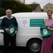 George Stone and Kathy with Neem Tree Trust bags next to our little white charity van