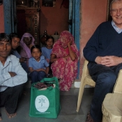 Michael Manser and his Neem Tree Trust bag with a weaving family in Savlas in Gujarat
