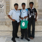 Three of the boys with a Neem Tree Trust bag at the Taj Mahal